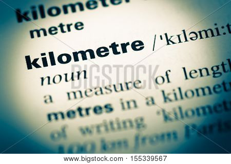 Close Up Of Old English Dictionary Page With Word Kilometre
