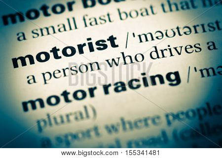Close Up Of Old English Dictionary Page With Word Motorist
