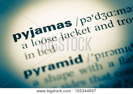 Close Up Of Old English Dictionary Page With Word Pyjamas