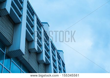 Architecture of the facade of a modern office building against the sky.