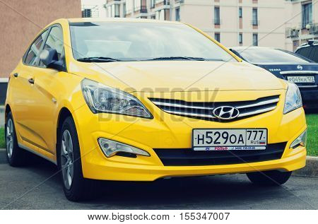 Sochi, Russia - October 12, 2016: New yellow Hyundai Solaris parked in the street of Munich. New korean automobile.