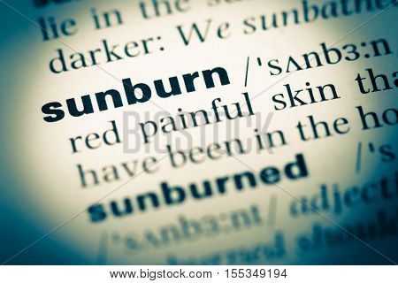 Close Up Of Old English Dictionary Page With Word Sunburn