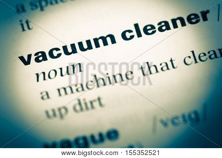 Close Up Of Old English Dictionary Page With Word Vacuum Cleaner