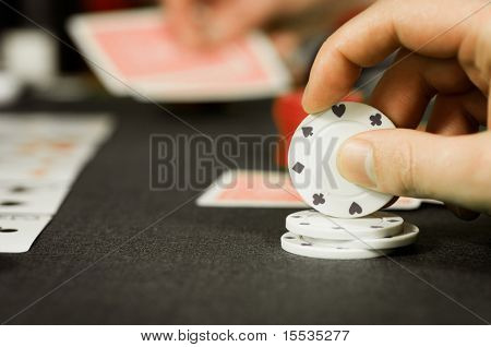 Poker players around a gambling table.