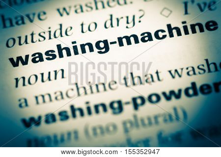 Close Up Of Old English Dictionary Page With Word Washing Machine