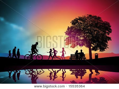 People Walking And Jogging, A Family Watching The Sunset.