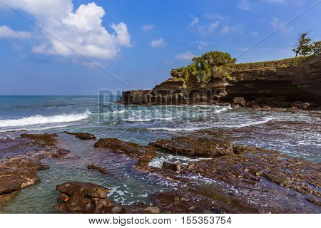 Beach near Tanah Lot Temple in Bali Indonesia - travel background