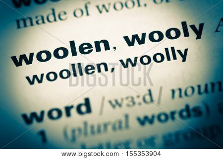 Close Up Of Old English Dictionary Page With Word Woolen Wooly