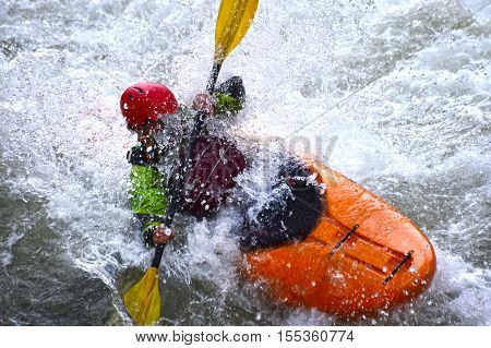 Extreme river kayaking as fun sport, splashing the whitewater