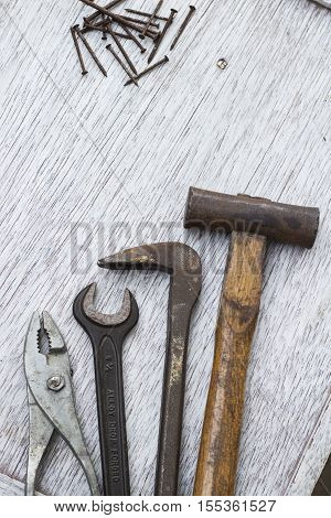 Hammer nail puller wrench plyer and nail carpenter's tools