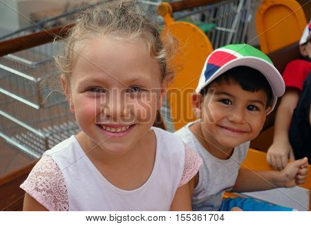 Happy beautiful little girl and little boy portrait outdoors