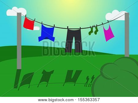 Clothes are drying on a rope on cartoon landscape with green grass and clouds on blue sky