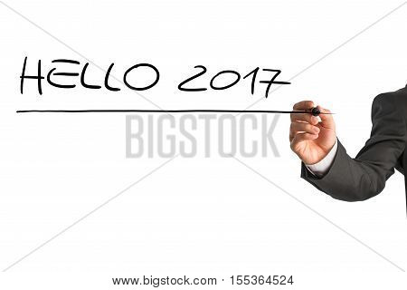 Male hand in business attire writing a Hello 2017 sign on a white virtual screen with a black marker.