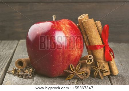 Apple, Cinnamon, Anisetree On A Dark Wooden Background. Toning