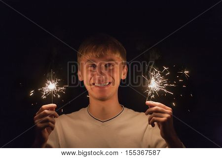 Portrait of a cheerful man with sparklers