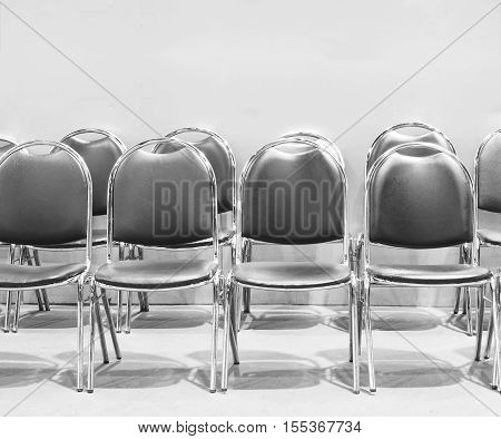 Row of chairs for waiting black and white color