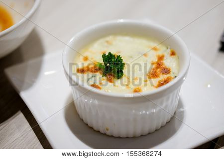 Close up spinach lasagna in white plate - Italian food style