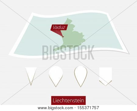 Curved Paper Map Of Liechtenstein With Capital Vaduz On Gray Background. Four Different Map Pin Set.