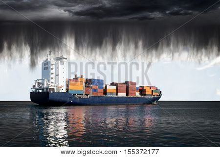 Sea landscape with container ship and rain over ocean.