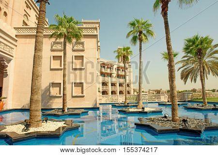 DUBAI, UAE - OCTOBER 14, 2016: Palm trees floating on little islands at the entrance to a lavish Dubai hote, Al Qasr