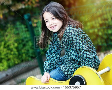 portrait of happy cute little girl in playground