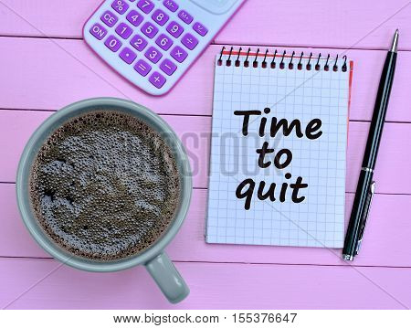 Time to quit words on notepad closeup