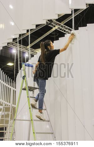 St. Petersburg, Russia - 2 October, She rubs the scenery, 2 October, 2016. Construction and preparation work for the St. Petersburg Gas Forum.