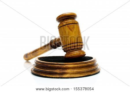Wooden judge hammer on the white background. horizontal photo.