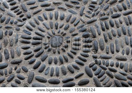 Texture of small stones sett on street