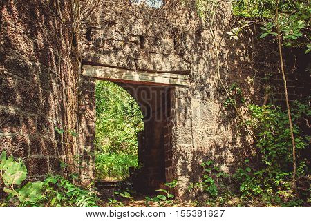 Abandoned Portuguese fort in the green jungle in India