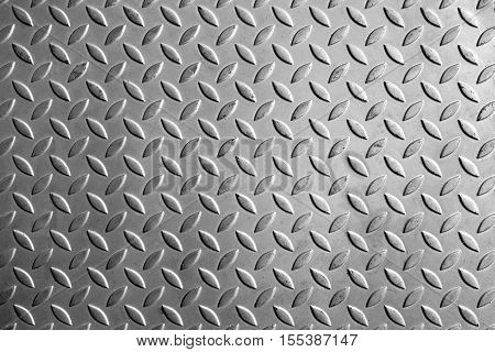The pattern texture of the metal plate for anti-slip texture purpose in hi-key effect.The emboss pattern texture background of the metal plate.