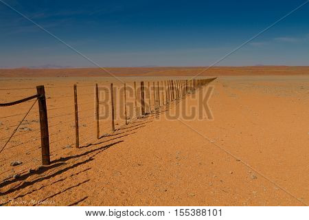 Fence in the Namibian desert in Southern Namibia