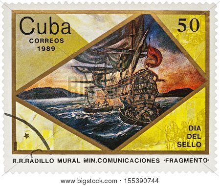 MOSCOW RUSSIA - NOVEMBER 07 2016: A stamp printed in Cuba shows ancient sailing ship and boats with sailors series
