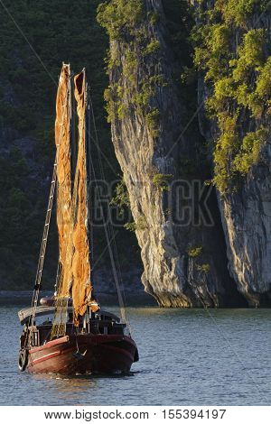 Cat Ba, Vietnam, October 27, 2016 : Traditional Junk Sails In The Evening In Cat Ba Archipelago, The