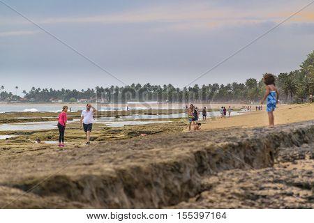 PORTO GALINHAS, BRAZIL, JANUARY - 2016 - People at tropical beach in Porto Galinhas Pernambuco Brazil