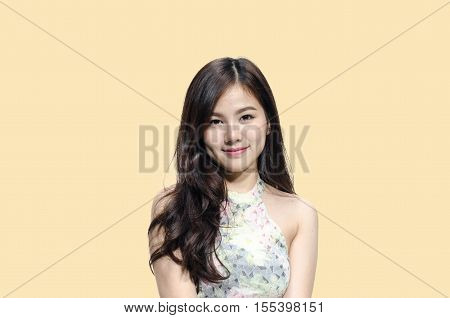 Asian woman smiling with dimple long hair black eyes on cream background
