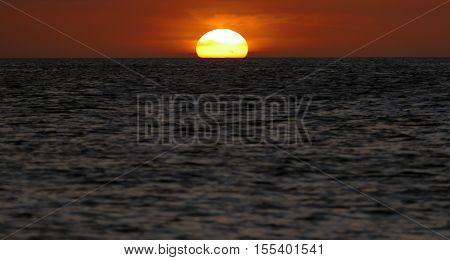 Incredibly beautiful sunset at Caribbean near the Equator at the azure ocean