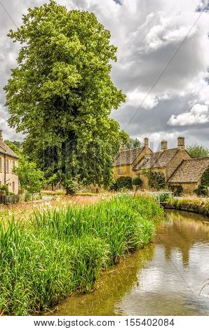 Scenic view of Lower Slaughter village in the Cotswolds, England.