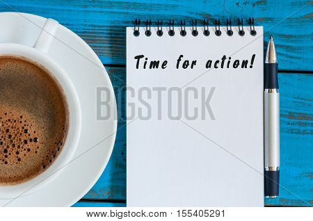 Hand writing Time for Action with notepad, pen and morning cup of coffee, business concept, empty space for text.