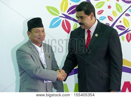 Porlamar Venezuela. September 17th 2016: Nepali Vice President Nanda Bahadur Pun and Venezuelan President Nicolas Maduro at the opening ceremony of the Non-Aligned Movement Summit in Porlamar Venezuela