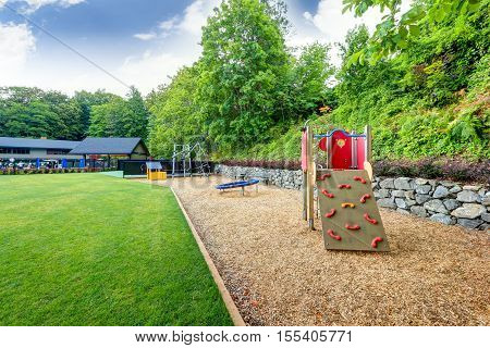 Playground Equipment Set For Children In Tacoma Lawn Tennis Club.
