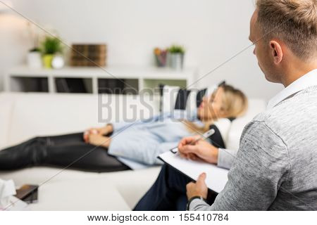 Woman lying on couch at doctors office