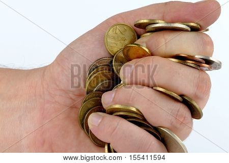 Handful of coins isolated on white background