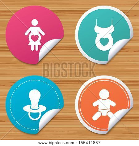 Round stickers or website banners. Maternity icons. Baby infant, pregnancy and dummy signs. Child pacifier symbols. Shirt with heart. Circle badges with bended corner. Vector