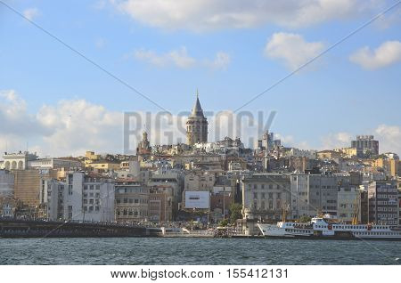 Istanbul Turkey - July 26 2016: Galata Bridge and Galata Tower in the background Istanbul views. This is a great place to see the colors of Istanbul. Interesting to see the fishermen on the bridge with the Galata tower in the background.