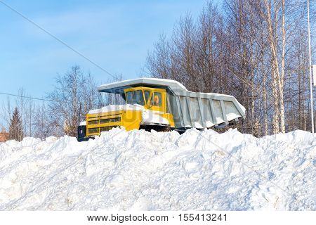 Dumper covered with snow in the winter
