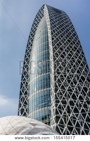 Tokyo Japan - October 2 2016: Closeup of the Cocoon Tokyo Mode Gakuen building and the dome building adjacent in Shinjuku neighborhood. Blue sky. Metal and glass construction with lots of triangles.