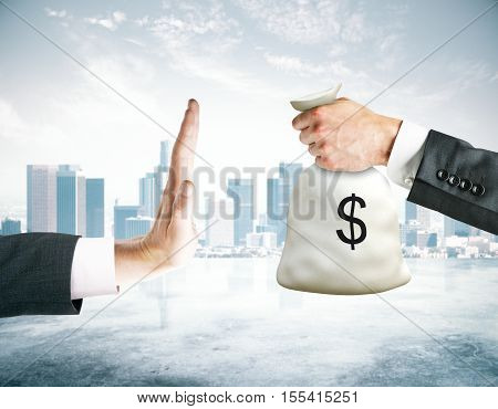 Hand saying no to money bag on city background. Stop corruption concept poster