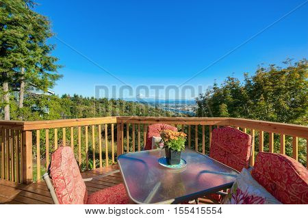 Wooden Walkout Deck With Red Table Set