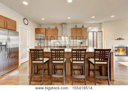 View Of Four Bar Stools In Modern Kitchen Room